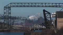 Industrial buildings, equipment, pipeline and structures span a river Stock Footage