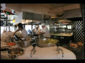 Stock Video Footage of Time-lapse of chefs and cooks preparing food in a professional kitchen.