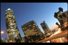 Time-lapse of city traffic under a darkening sky. Stock Footage
