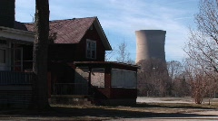 A boarded up home located near a nuclear power plant Stock Footage