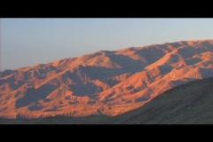 Mountains turn orange in glowing light. Stock Footage