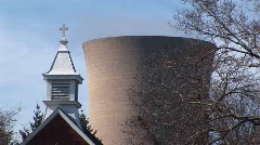 A church steeple and a nuclear power plant in close proximity Stock Footage