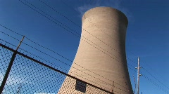 A nuclear power plant is protected by a high cyclone fence Stock Footage