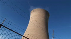 Steam drifts slowly from the top of a nuclear power plant Stock Footage