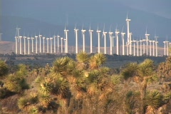Windmills spin on a wind farm. Stock Footage