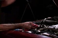 A mechanic checks the oil dipstick. Stock Footage
