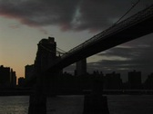 Stock Video Footage of Brooklyn Bridge and skyscrapers of Manhattan silhouetted
