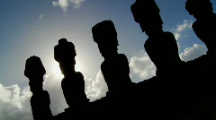 Easter Island statues are silhouetted against the sky. - stock footage