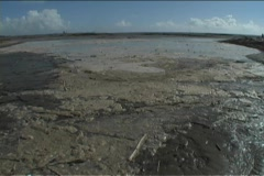 An accelerated view of debris moving through water. Stock Footage