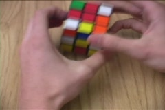 An accelerated view of a person conquering a Rubik's cube. - stock footage
