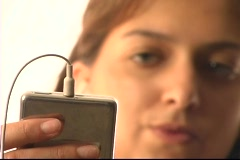 A woman jams out with an MP3 player. Stock Footage