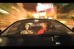 An accelerated shot of a car driving through city streets with two passengers, a Stock Footage