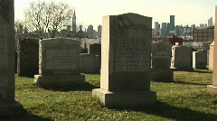 Cemetery with the skyline of New York in the background Stock Footage