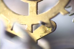 Rotating teeth on a wheel gear move a lever in this close-up. Stock Footage