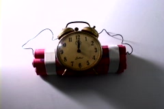 A shadow slowly circles around a homemade time bomb. Stock Footage