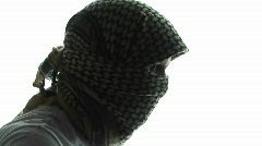 A terrorist, in profile, wears a kaffiyeh scarf. Stock Footage