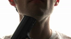 A man puts a pistol against his throat and pulls the trigger, Stock Footage