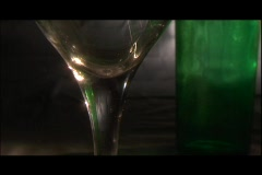 White wine and a lemon wedge fills a goblet. Stock Footage