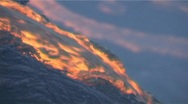 Stock Video Footage of Red hot lava flows over the rim of a volcanic cone during an