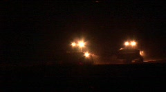 A night patrol of armored bulldozers moves along the Gaza Strip Stock Footage