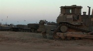 Armored vehicles wait at an Israeli army staging post  Stock Footage