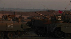 Israeli armored vehicles wait at an army staging post on the Stock Footage