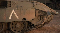 An Israeli tank lowers its gun along the Gaza Strip border area. Stock Footage