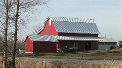 This bright red barn stands out on this rather cloudy winter day Stock Footage