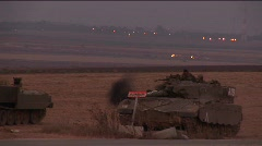 A soldier climbs down from an Israeli tank. Stock Footage