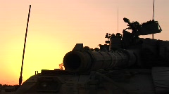 The barrel of an Israeli tank is silhouetted against an orange sky. Stock Footage