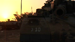 An Israeli tank is silhouetted against a multi colored sky. Stock Footage