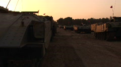 A line of armored vehicles sit on the Israel - Gaza Strip border. Stock Footage