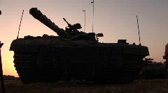 An Israeli army tank is parked on the border of the Gaza strip. Stock Footage