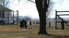A group of Amish young people are playing games outdoors Stock Footage