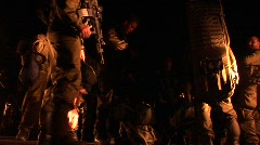 Israeli soldiers with guns mill about during a night patrol. Stock Footage