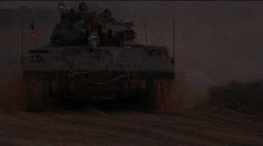 An Israeli tank passes at high speed during an early morning Stock Footage
