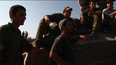 Off duty Israeli soldiers sit on a tank talk. Stock Footage