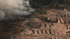 Smoke rises from a rocket attack in Northern Israel during the Stock Footage