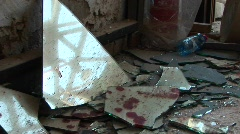 Blood stained pieces of broken glass lie scattered after a suicide Stock Footage