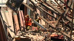 Workers walk through a damaged building in Haifa Stock Footage