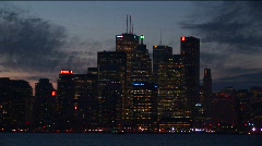 Toronto, at night, with lights from across Lake Ontario Stock Footage