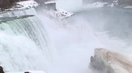 Stock Video Footage of Niagara Falls with a large ice chunk in the foreground