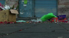 Trash and garbage line an urban city street. Stock Footage