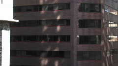 Pan-up of a modern office building Stock Footage