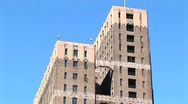 An older high-rise building with ornate masonry Stock Footage