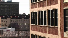 Medium-shot of the windows of a brick building Stock Footage