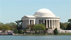 Tourists walk around the Jefferson Memorial in Washington, DC Stock Footage