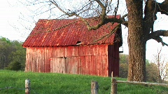 Faded red roof and siding of an old barn Stock Footage