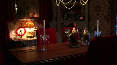 Candles sit on a formal dining table under a chandelier Stock Footage