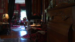 Victorian antiques abound inside a richly decorated living room Stock Footage